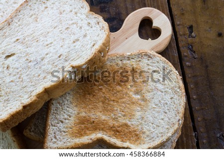 Sliced Whole Grain Bread served on chop board