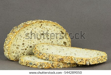 Sliced wholemeal grain bread on a brown background