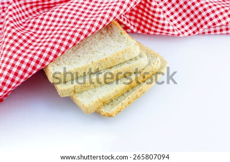 sliced wholewheat bread and napkin on white background with place for your text - stock photo
