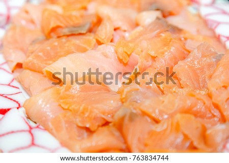 sliced wild salmon on a platter