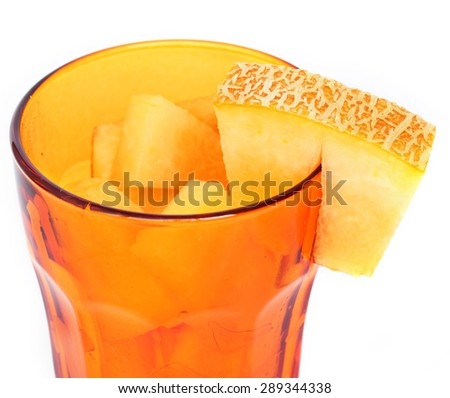 Sliced yellow melon for fresh salad or juice in color glass.Colorful healthy food and drinks.Summer fruit and vegetables. Healthy food.Macro.Selective focus. Natural blur. Isolated on white background - stock photo