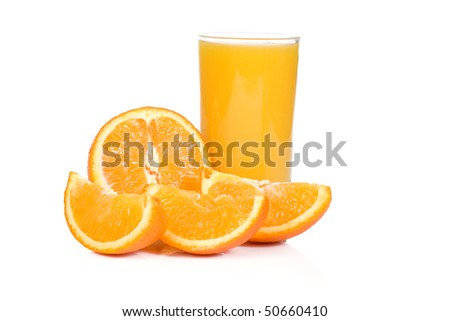 sliced yellow orange and juice on white