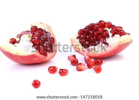 Slices and seeds pomegranate. - stock photo