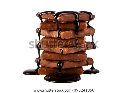 Slices chocolate bar poured chocolate isolated on white background - stock photo
