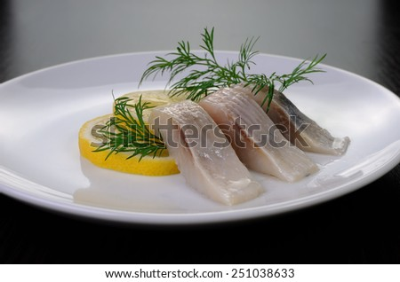 slices delicates  of herring with lemon dill