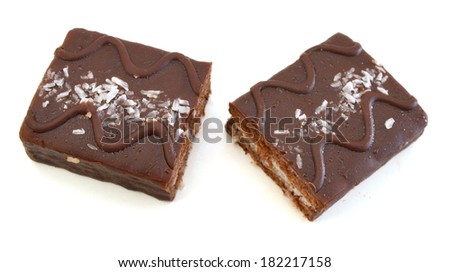Slices of a brownie on white background covered with  - stock photo