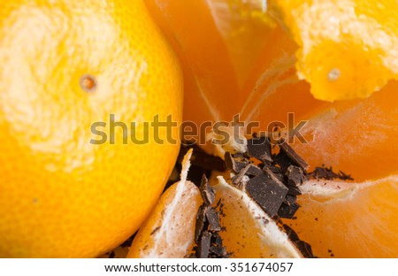 slices of a orange with chocolate