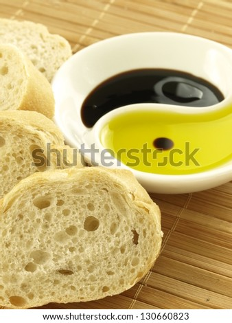 Slices of baguette and bowl of oil