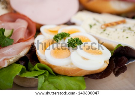 Slices of boiled eggs on bread displayed in coffee shop