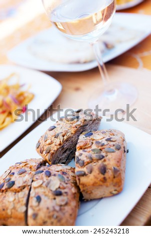Slices of bread and white wine in the glas - stock photo