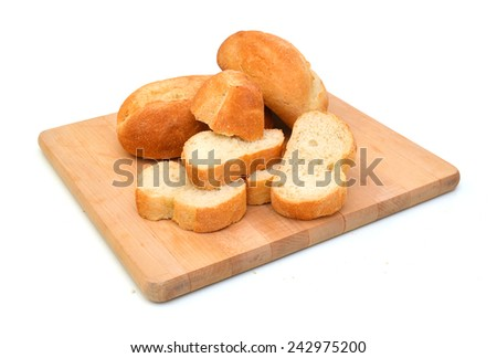 Slices of bread isolated on wooden board on white background  - stock photo