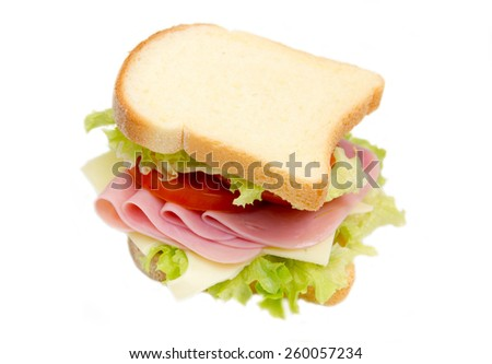 Slices of bread with ham and salad on white background