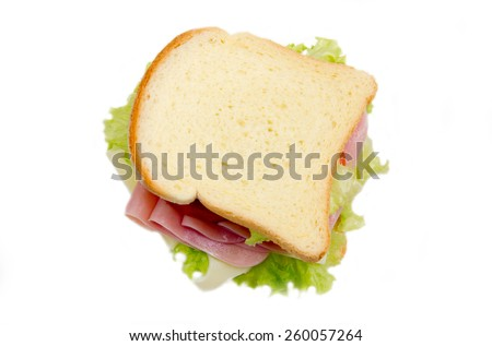 Slices of bread with ham and salad on white background seen from above - stock photo
