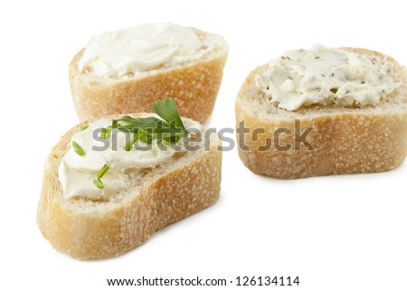 Slices of bread with herb butter lying on a white surface