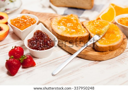 Slices of bread with jam for breakfast - stock photo