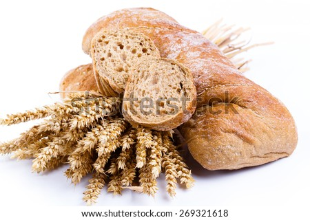 Slices of bread with rye on a white background. - stock photo
