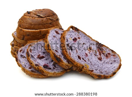 Slices of brown bread with nut on white background