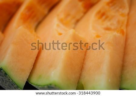 slices of cantaloupe melon closeup - stock photo