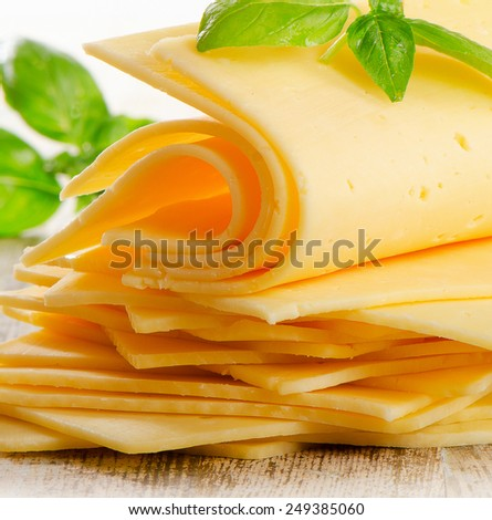 Slices of cheese with fresh herbs. Selective focus