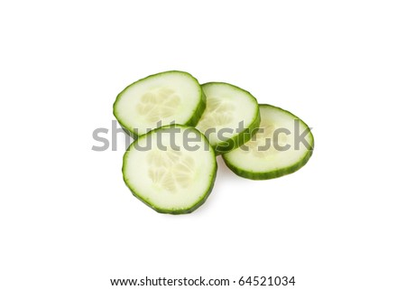 Slices of cucumber isolated on white - stock photo