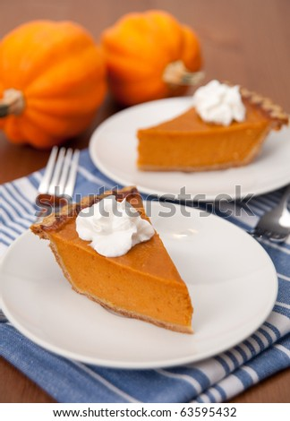 Slices of Delicious Fresh Pumpkin Pie with Wipped Cream - stock photo
