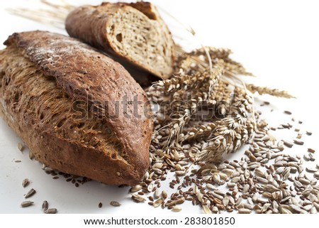 Slices of finest organic bread decorated with natural cereals and sunflowers seeds, isolated on white background - stock photo
