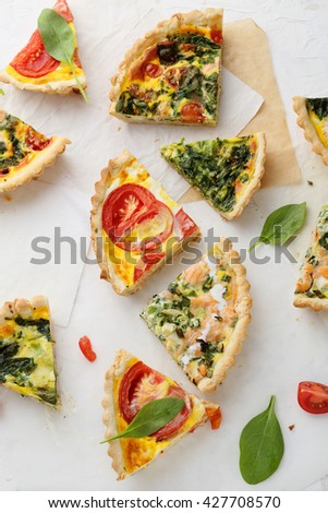 slices of french pies on white background
