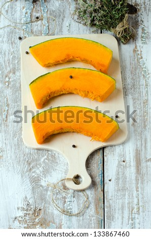 Slices of fresh pumpkin, selective focus. - stock photo