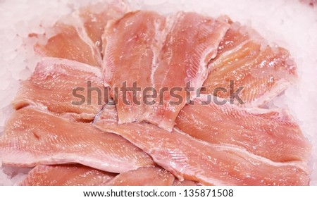 Slices of fresh salmon in supermarket