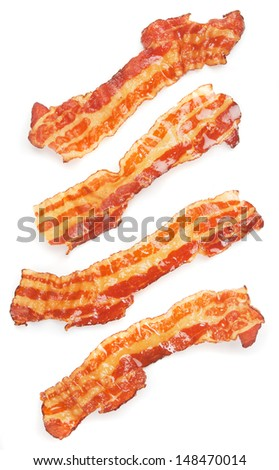 Slices of fried bacon isolated on white background - stock photo