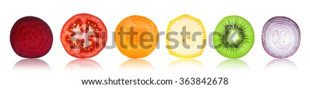 Slices of fruit and vegetable on white background - stock photo