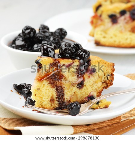 Slices of fruit pie with berries in white plates and jam in bowl. - stock photo