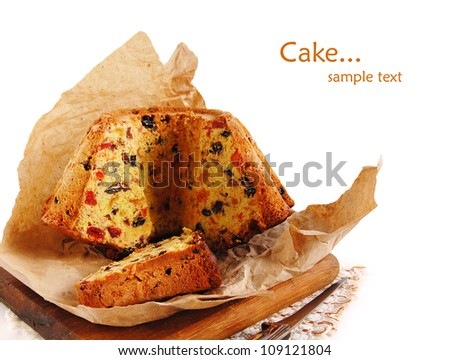 Slices of fruitcake with knife on the white background - stock photo
