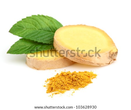 Slices of ginger with mint - stock photo