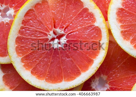 Slices of grapefruit on white