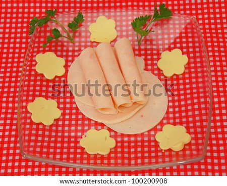 Slices of ham and cheese in flower shape - stock photo
