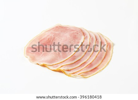 Slices of ham salami on white background