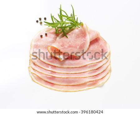 Slices of ham salami on white background - stock photo