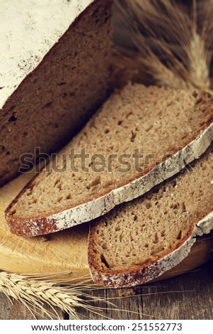 Slices of homemade bread on rustic wooden background
