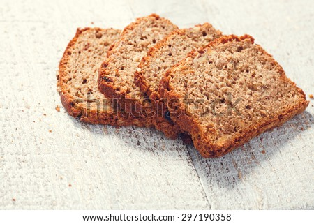 Slices of homemade whole grain bread on the boards, closeup