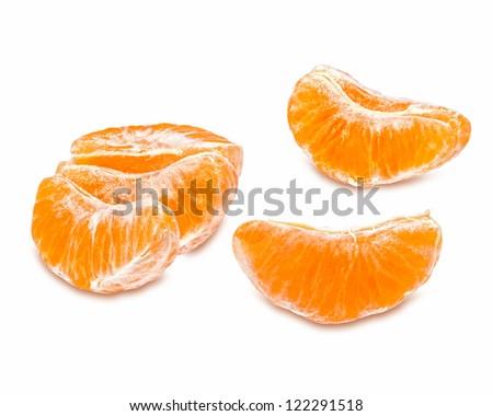 Slices of juicy tangerine isolated on white background - stock photo