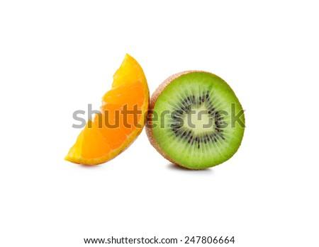 slices of kiwi and orange on a white - stock photo