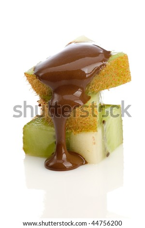 slices of kiwi with pouring chocolate - stock photo