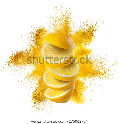 Slices of lemon flying against yellow powder explosion isolated on white background