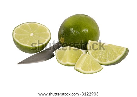 slices of lime with paring knife on a white background - stock photo