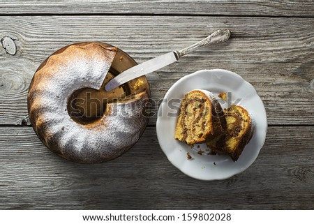 Slices of marble cake sprinkled with sugar - stock photo