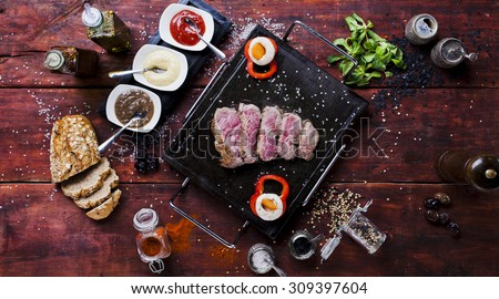 Slices of meat served on the grill plate - stock photo