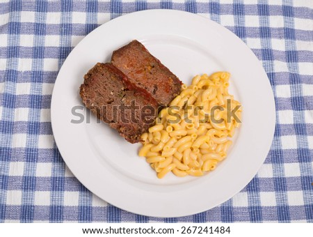 Slices of meatloaf with macaroni and cheese - stock photo
