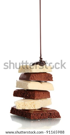 Slices of milk and white chocolate bar poured chocolate isolated on white