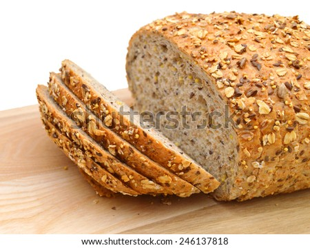 slices of multigrain bread, isolated on wooden board on white  - stock photo